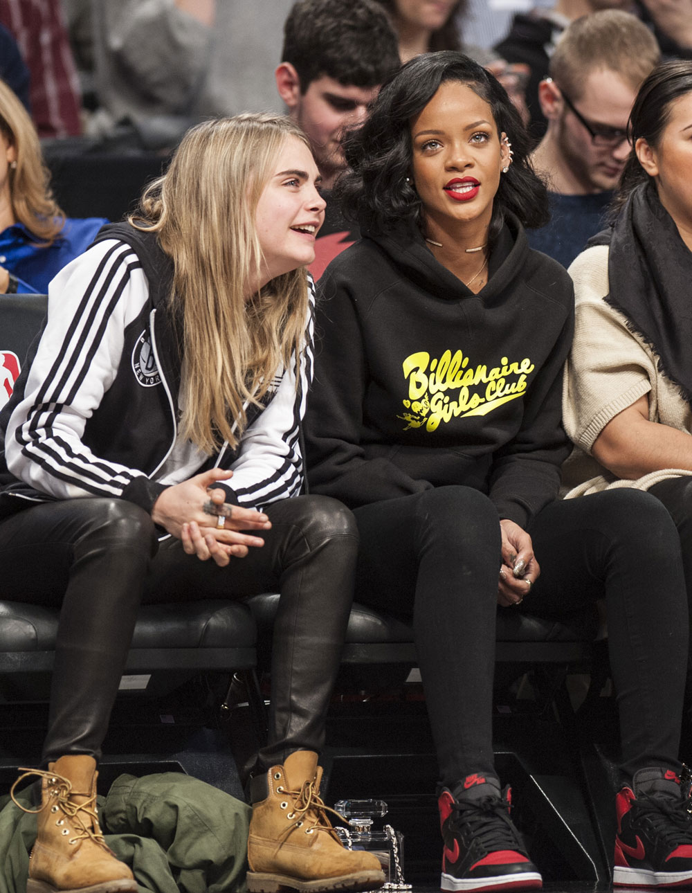 Rihanna Rocks Two $9,500 Chanel Purses To Nets Game With Cara Delevingne