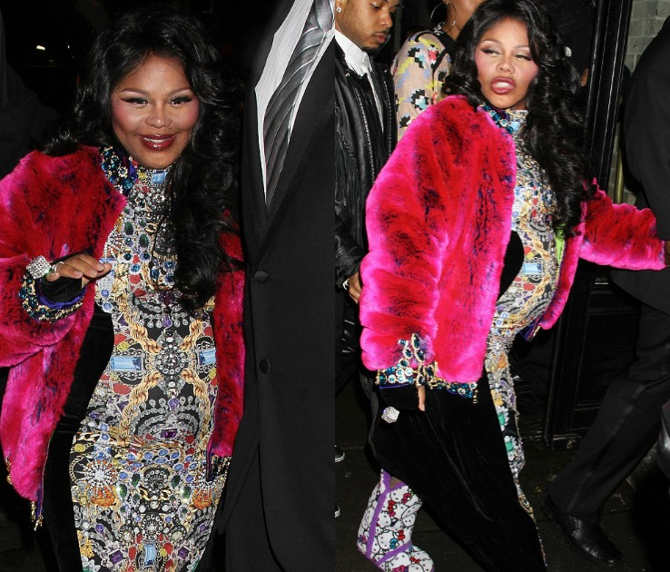 Lil Kim Arrives To New York Fashion Week With Surprise Baby Bump